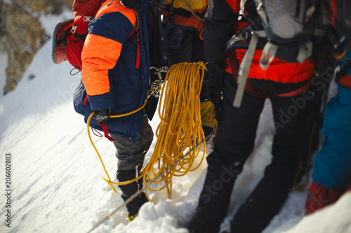 Fotobehang Alpinisme Climbers before climbing. Climbing gear and equipment close up. Tilt-shift effect.