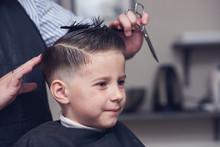 Cheerful Caucasian Boy  Getting Hairstyle In Barbershop.