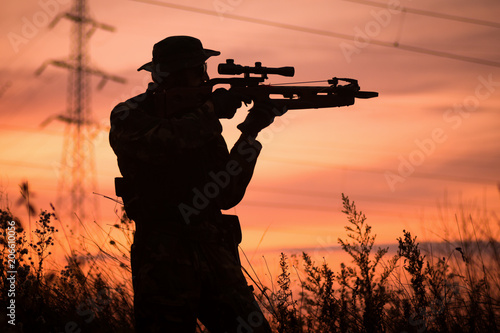Canvas Print hunter with crossbow silhouette