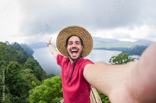 Valokuva Crazy handsome man taking a selfie on a scenic landscape