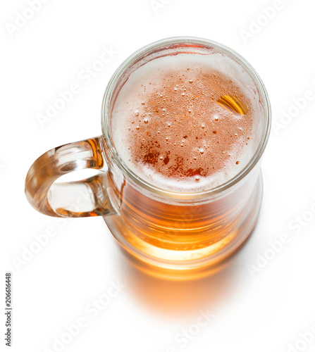 Photographie top view of mug of lager beer isolated on white background