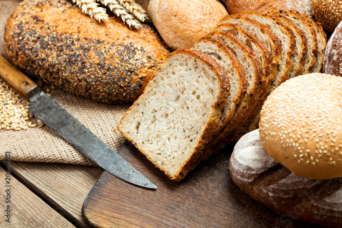 Foto op Aluminium Brood heap of various bread on wooden background