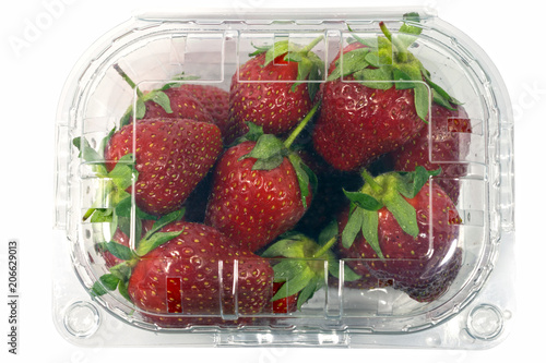 Strawberry package isolated on a white background with a clipping path. View from top.Supermarket shop plastic box container with fresh sweet fruits.