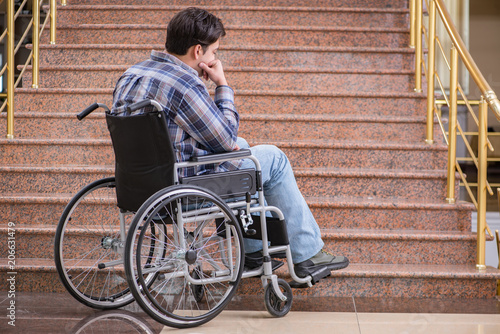 Fototapeta  Disabled man on wheelchair having trouble with stairs