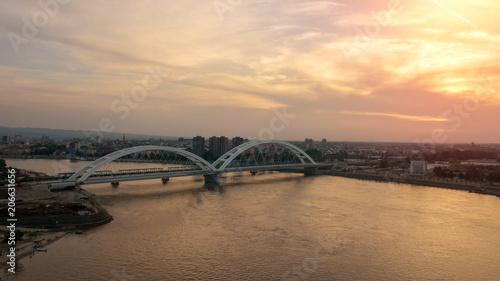 Poster Artistiek mon. Beautiful drone shot of Novi Sad bridge at sunset