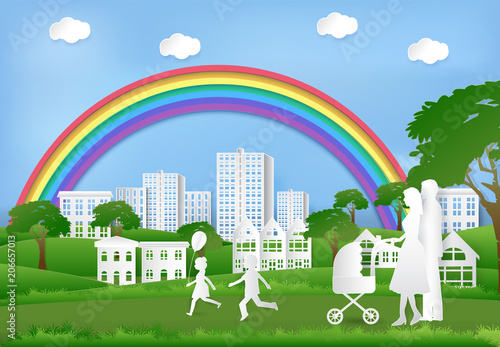 Foto op Plexiglas Groene Happy family having fun in the park and rainbow on blue sky, Paper art background