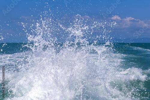 Staande foto Zee / Oceaan Blue ocean sea water wave with fast yacht boat wake foam of prop wash