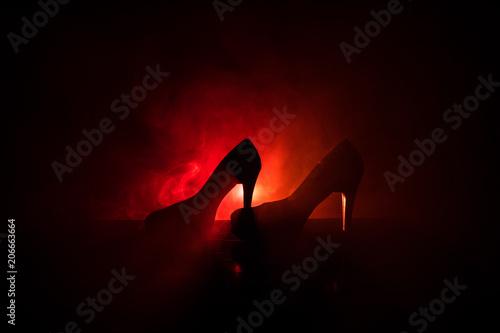 Black suede high heel women shoes on dark toned foggy background Canvas-taulu
