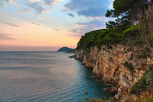 Cliff Face With The Sea And A Beautiful Sunset With Birds Flying In The Sky - Island Of Kolocep In Croatia