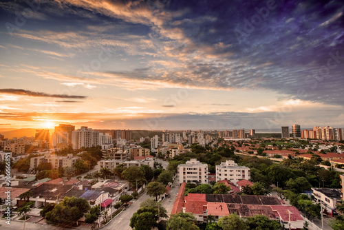 Deurstickers Luchtfoto Aerial view of Barranquilla, Colombia towards the river at sunset