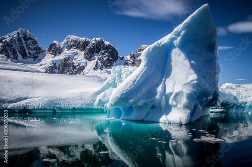 Photo Stands Antarctica Reflecting iceberg in Antarctica