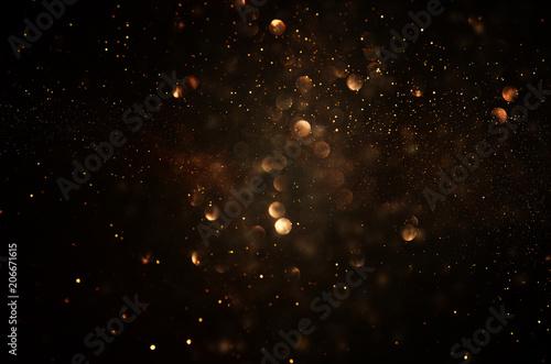 glitter vintage lights background. dark gold and black. de focused. - 206671615