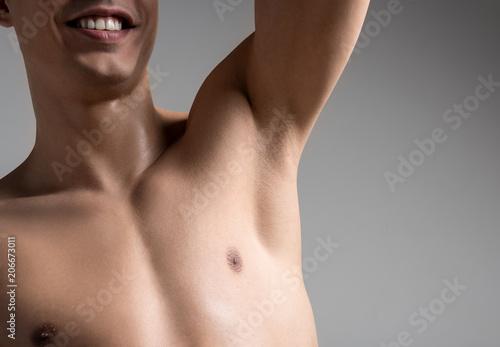 Close up of armpit of cheerful young shirtless man Fototapeta