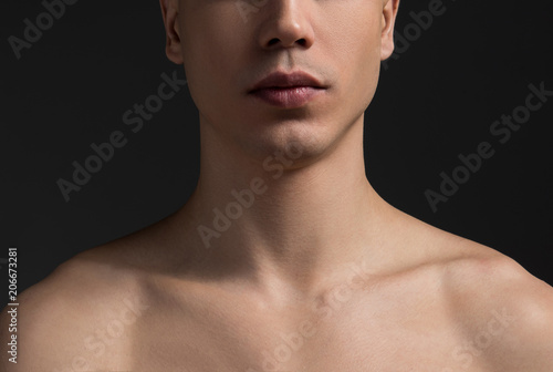Canvas Print Close up of young male neck and half of face