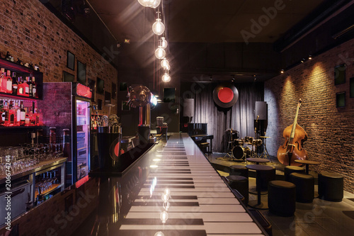 Modern jazz bar interior design, stage with black piano and cello ...