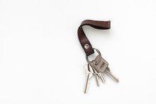 Keys Attached To Leather Keychain On White Background