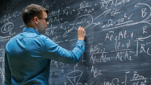 Brilliant Young Mathematician Approaches Big Blackboard and Finishes writing Sophisticated Mathematical Formula/ Equation Canvas Print