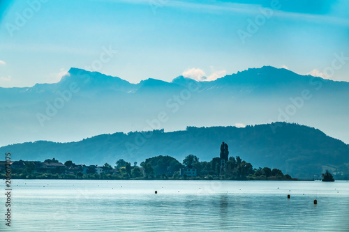 Valokuva  Foggy morning landscape on the shores of the Obersee (Upper Lake Zurich) , Switz