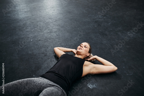 Fotografie, Obraz  Fit young woman doing sit ups at the gym