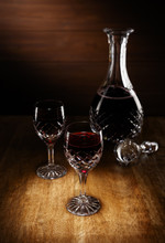 2 Glasses Of Port And A Decanter On An Antique Wooden Table.