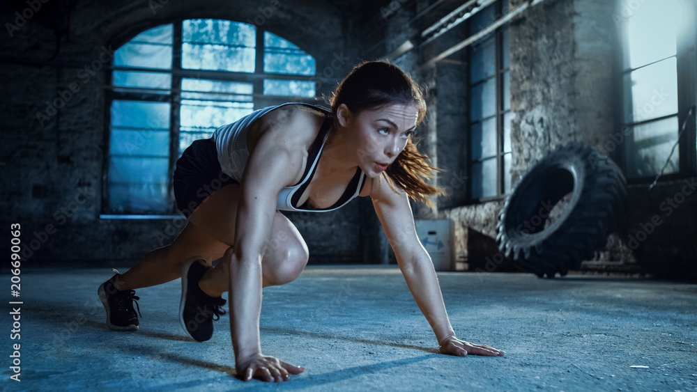Fototapety, obrazy: Athletic Beautiful Woman Does Running Plank as Part of Her Cross Fitness, Bodybuilding Gym Training Routine.