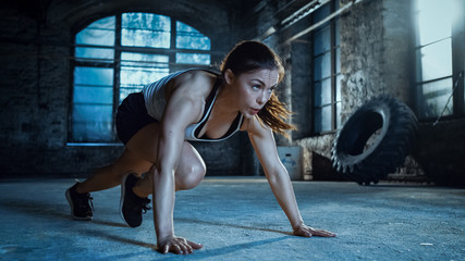 Fototapeta na wymiar Athletic Beautiful Woman Does Running Plank as Part of Her Cross Fitness, Bodybuilding Gym Training Routine.