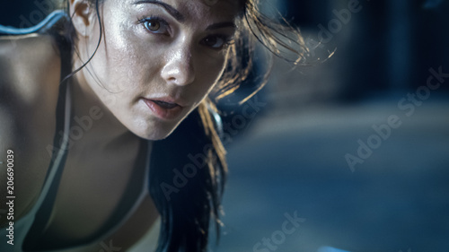 Fotografia, Obraz  Close-up Shot of a Beautiful Athletic Woman Looks into Camera