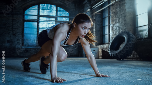 Poster Fitness Athletic Beautiful Woman Does Running Plank as Part of Her Cross Fitness, Bodybuilding Gym Training Routine.