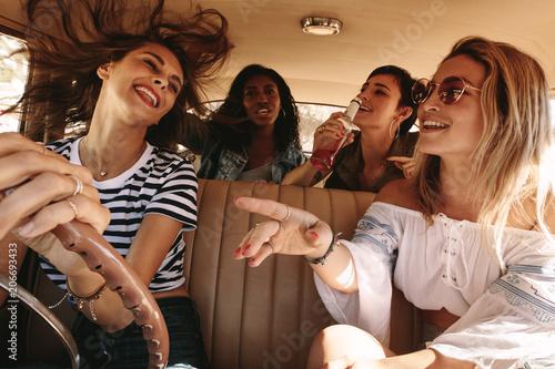 Girls having fun on road trip