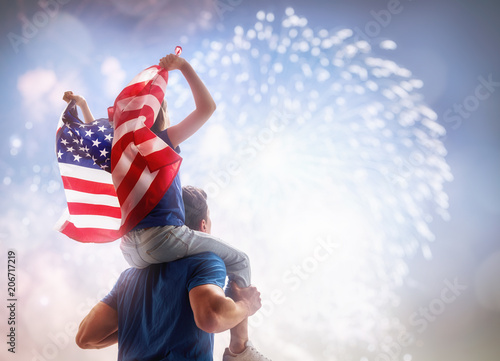 Photo  People holding the Flag of the USA.