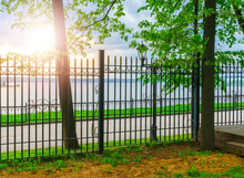 Lantern And Fence In The Park In Sunlight At Sunset In Izhevsk, In Russia