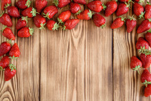Tasty Strawberry On A Wooden Table. It Can Be Used As A Background