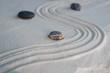 Pyramids of gray zen stones on light sand. Concept of harmony, balance and meditation, spa, massage, relax