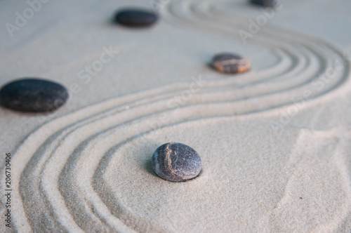 Foto op Aluminium Stenen in het Zand Pyramids of gray zen stones on light sand. Concept of harmony, balance and meditation, spa, massage, relax