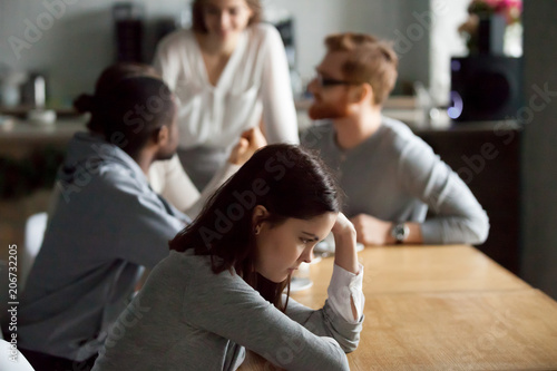 Fotografía Sad frustrated young girl feeling lonely sitting alone at cafe table, upset soci