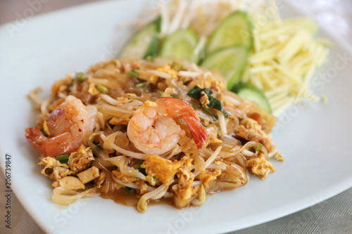 Shrimp pad thai noodles with shrimps on top , Thai food