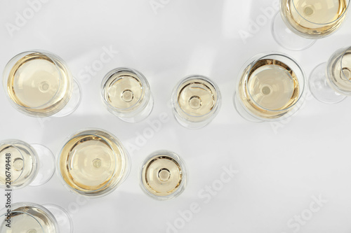 Fotografía  Glass of expensive white wine on light background, top view