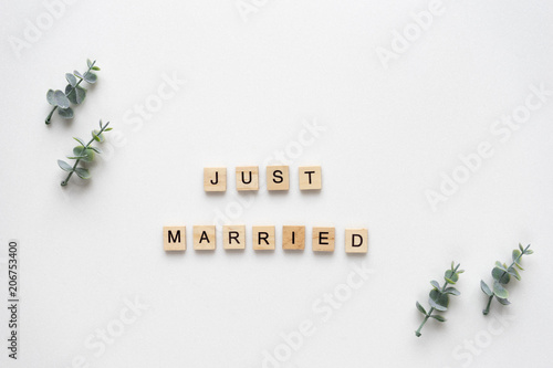 Fotografie, Obraz  Wooden letters  speling just married with oregano branches on white marble
