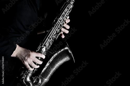 Poster de jardin Musique Saxophone player hands closeup. Saxophonist