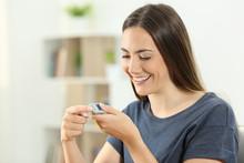 Happy Diabetic Girl Checking B...