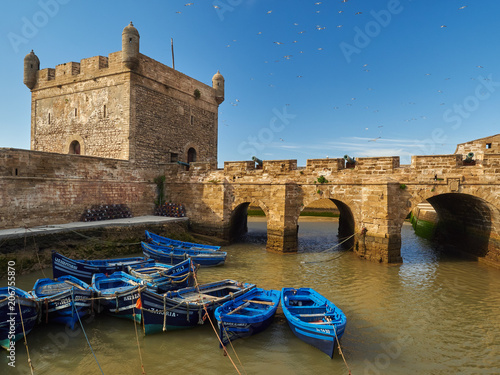 Staande foto Afrika Port city of Essaouira, ancient stone buildings, boats on the water,the Morocco.