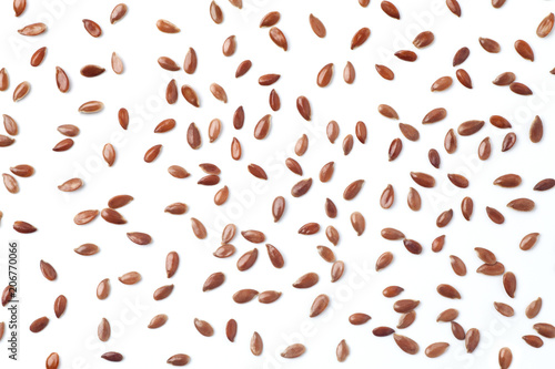 Brown flax seeds on white background