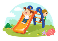 Cute Kids Having Fun On Slide In Playground