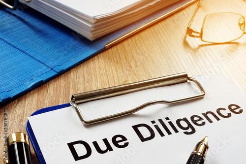 Obraz na plátně  Document with title Due Diligence on a desk.