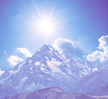 Mount Top In A Snow Under A Sparkle Sun, Natural Violer Colorised Background