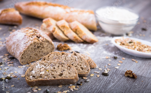 Foto op Aluminium Brood loaf of bread on a wooden board