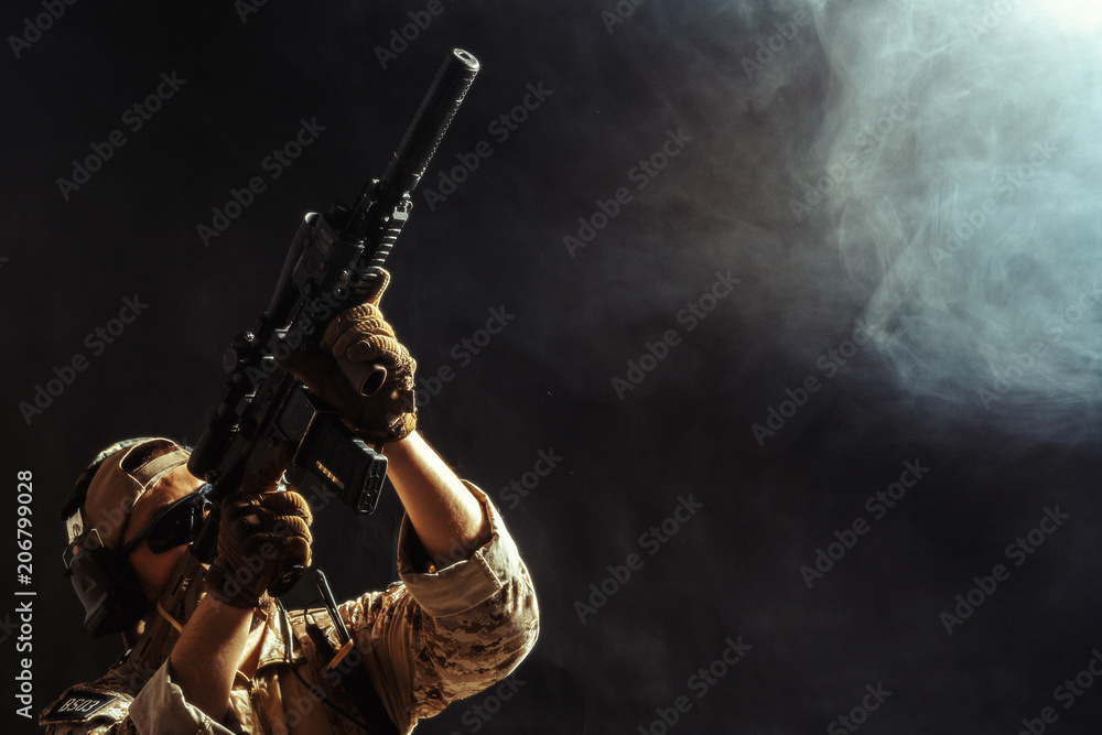 Fototapeta Special forces soldier with rifle on dark background