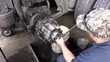 Man working on transport truck in garage repair shop