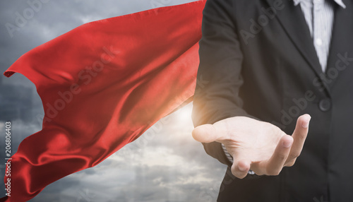 Photo  confident business superhero man wearing red cape against with city background