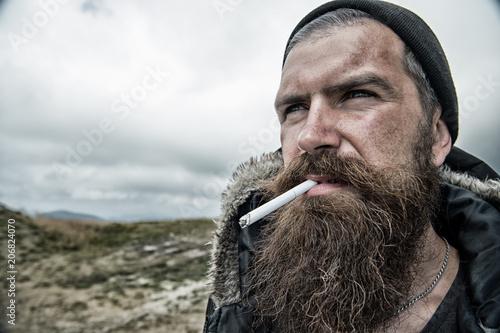 Fényképezés  Man with long beard and mustache smoking cigaret